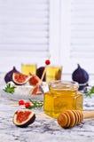 Miel d'or liquide Images stock