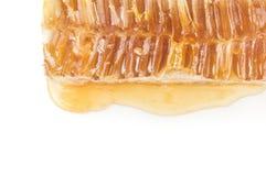 Miel dulce aislada en un recorte blanco del fondo Imagen de archivo