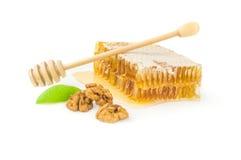 Miel dulce aislada en un recorte blanco del fondo Fotos de archivo