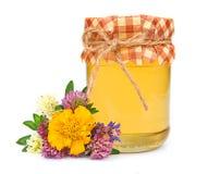 Miel dulce con las flores Foto de archivo libre de regalías
