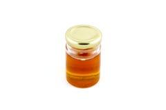 Miel en botellas de cristal Imagenes de archivo