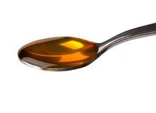 Miel en cuchara Foto de archivo