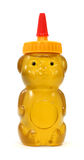 Miel en envase plástico del oso imagenes de archivo