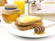 Miel en tostada Fotografía de archivo