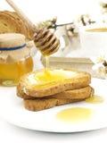 Miel en tostada Fotografía de archivo libre de regalías