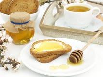 Miel en tostada Fotos de archivo libres de regalías