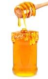 Miel en un tarro Fotografía de archivo libre de regalías