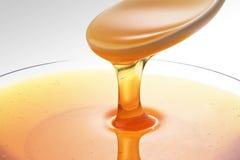 Miel en vidrio Imagenes de archivo