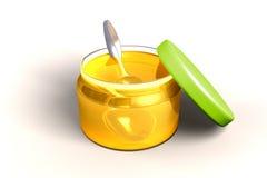 Miel et cuillère Images stock