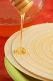 Miel et gaufre circulants Photographie stock libre de droits