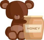 Miel et ours Cub Photographie stock