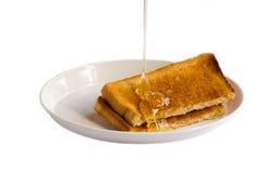 Miel et pains grillés Images libres de droits