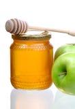 Miel et pommes Photos libres de droits