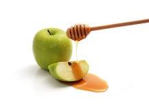 Miel et pommes vertes. Images libres de droits