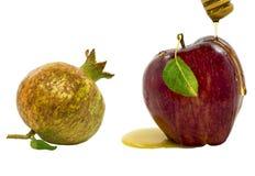 Miel, granada y manzana aisladas en blanco Fotografía de archivo libre de regalías