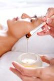 Miel pour le massage facial Image libre de droits