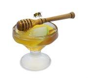 Miel y abeja en blanco Foto de archivo libre de regalías