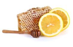 Miel y limón aislados en el fondo blanco Imágenes de archivo libres de regalías