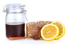 Miel y limón aislados en el fondo blanco Imagen de archivo libre de regalías