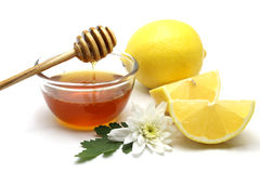 Miel y limón en el fondo blanco Imagen de archivo libre de regalías