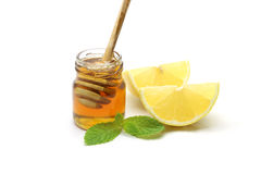 Miel y limón en el fondo blanco Fotos de archivo