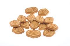Miele, biscotti del latte isolati Fotografie Stock
