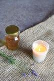 Miele, candela e lavanda immagine stock libera da diritti