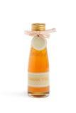 Miele dolce in una bottiglia Fotografie Stock