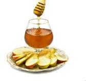 Miele e trasparenze della mela isolati su bianco Fotografia Stock Libera da Diritti