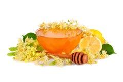 Miele fresco con i fiori del tiglio Fotografia Stock