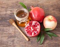 Miele, mela e melograno isolati per la festa tradizionale ha Fotografie Stock
