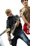 Miembro de una venda con la guitarra baja Imagen de archivo libre de regalías
