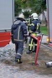 Miembros del departamento de bomberos Foto de archivo libre de regalías