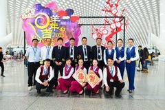Miembros del equipo de China Southern Airlines Imágenes de archivo libres de regalías