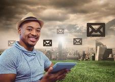 Mienie emaila i pastylki ikony nad miastem Obraz Royalty Free