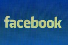 Pixelated Facebook shortcut on computer monitor close up shot. royalty free stock images