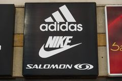 Adidas, Nike and Salomon logos on the street. royalty free stock photos