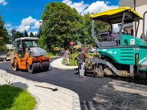 Road roller and asphalting machinery close up shot . stock photos