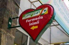 Heart shaped Catena pharmacy business logo.