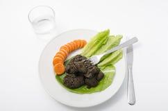Mierda gastrónoma con las verduras Imagen de archivo
