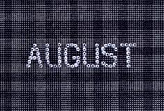 Miesiąc SIERPIEŃ zrobi rhinestones krystaliczny kolor na czarnej kanwie Obrazy Stock