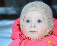 10 miesięcy stary dziecko w zimie odziewa Obrazy Royalty Free