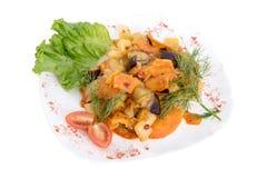 Mieszani gulaszy warzywa na talerzu odizolowywającym na bielu zdjęcia stock