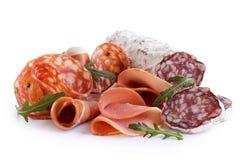 Mieszany powietrze leczył pokrojonych mięsa odizolowywających na bielu zdjęcia stock