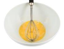 Mieszany yolk i proteina w pucharze obraz royalty free