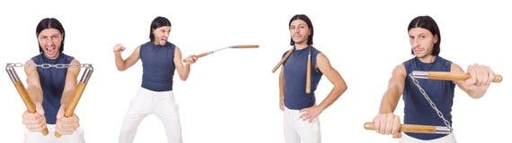 Śmieszny karate wojownik z nunchucks na bielu Obraz Royalty Free