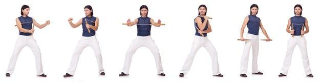 Śmieszny karate wojownik z nunchucks na bielu Zdjęcie Royalty Free