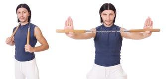 Śmieszny karate wojownik z nunchucks na bielu Fotografia Stock