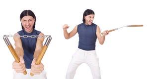 Śmieszny karate wojownik z nunchucks na bielu Obraz Stock
