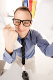 Śmieszny obrazek biznesmen w biurze Fotografia Stock